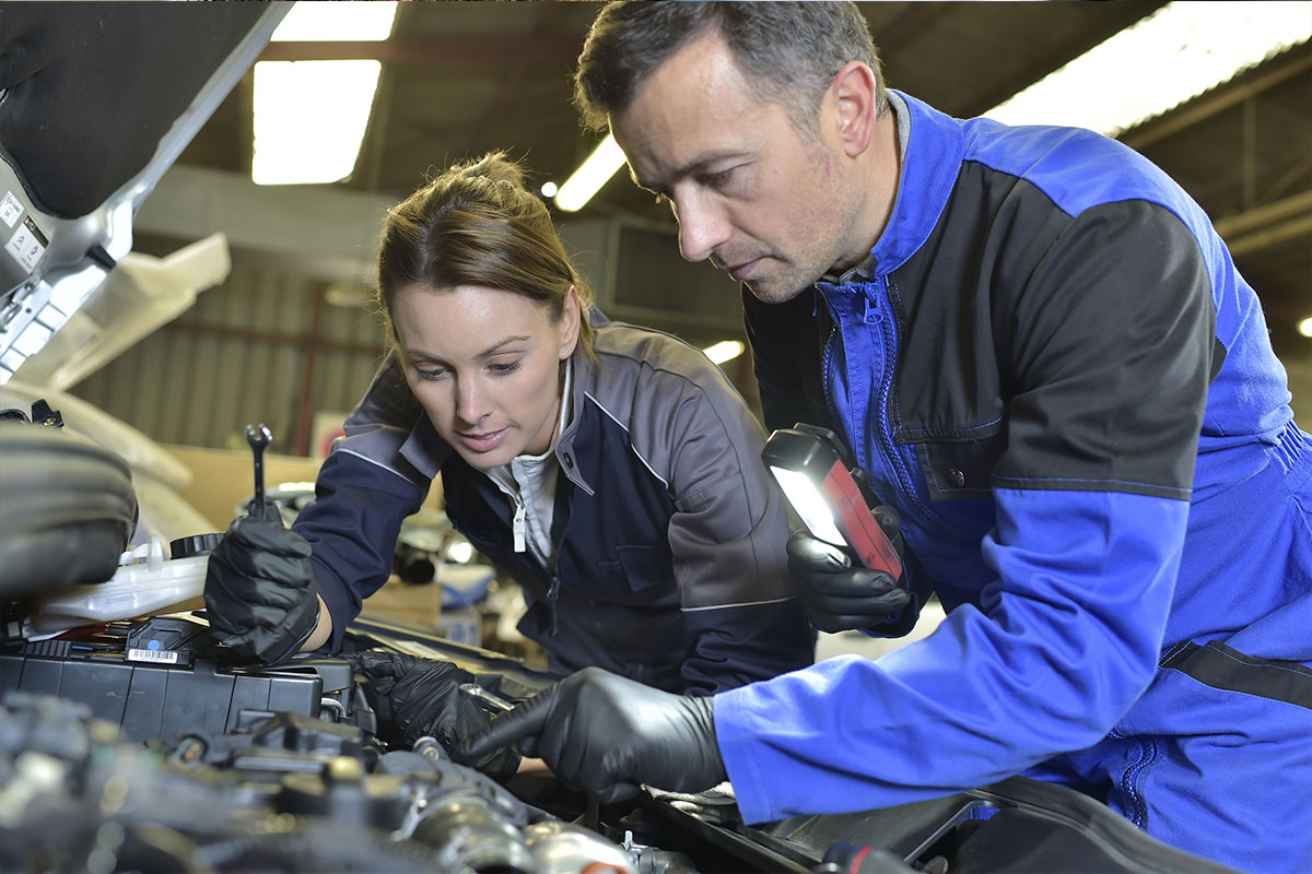 Mechanic giving on the job training